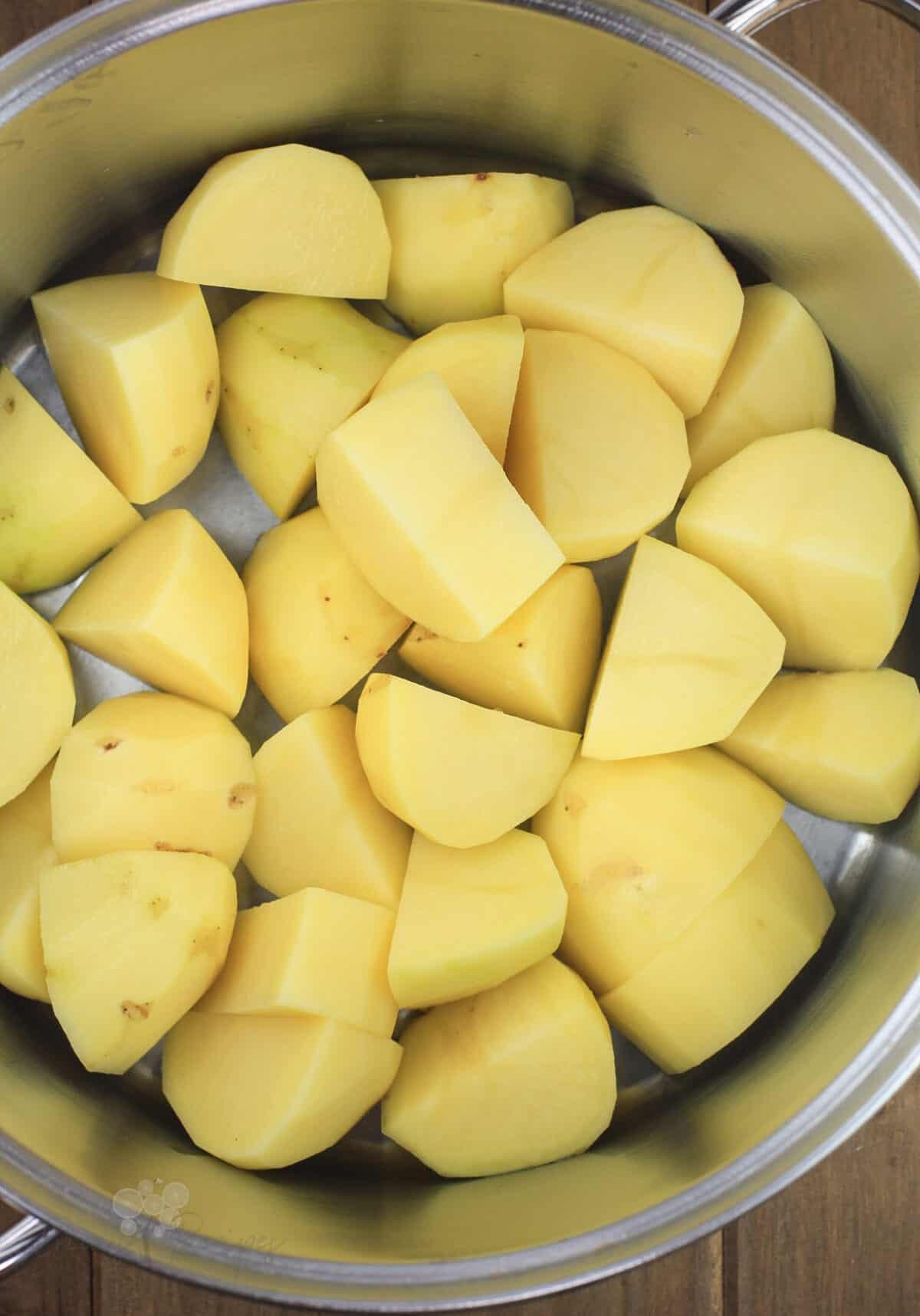 cut potatoes in pot