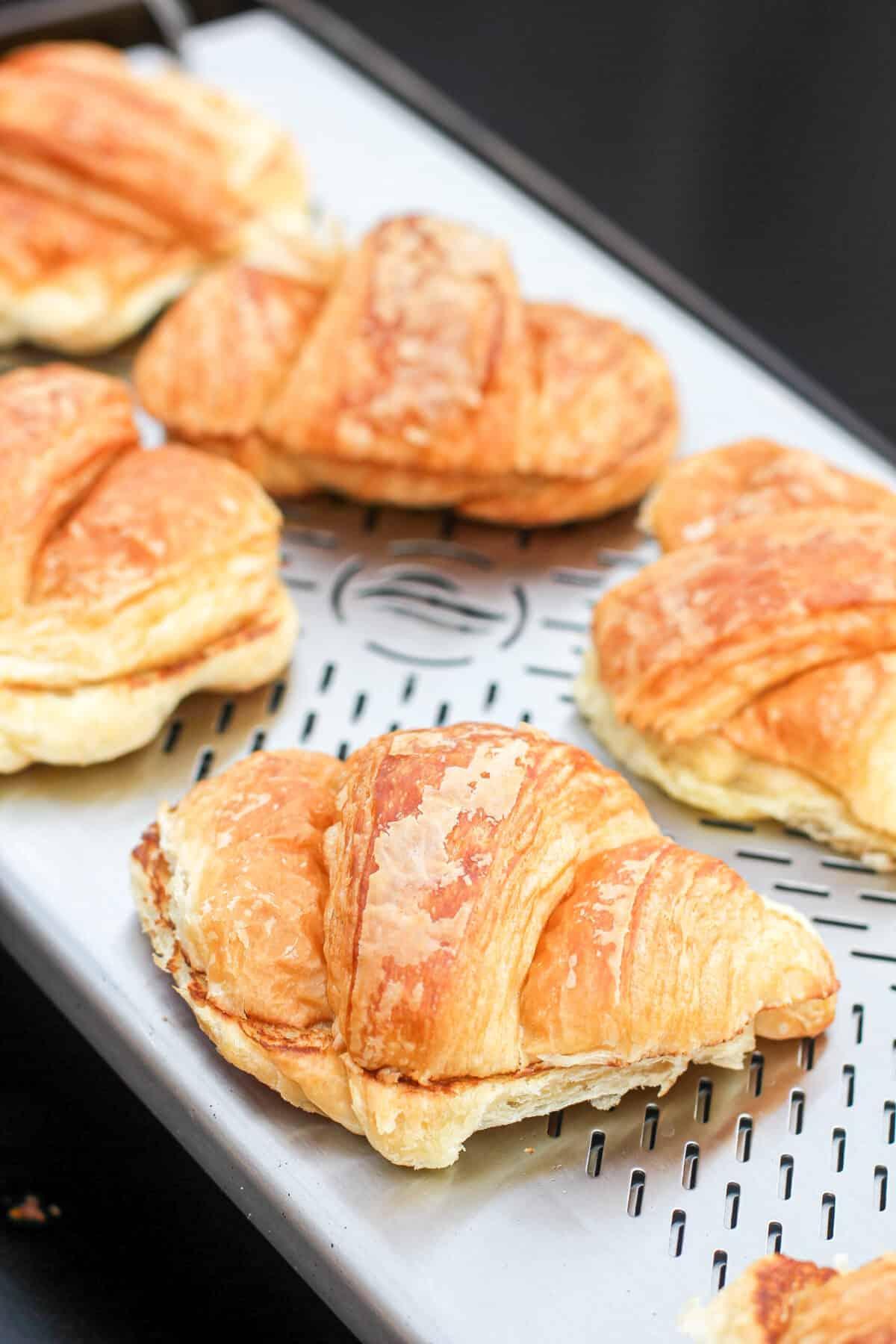close view of croissants sitting on Blackstone warmer rack