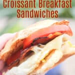 image of prepared recipe for Pinterest with text overlay recipe title Blackstone Croissant Breakfast Sandwiches