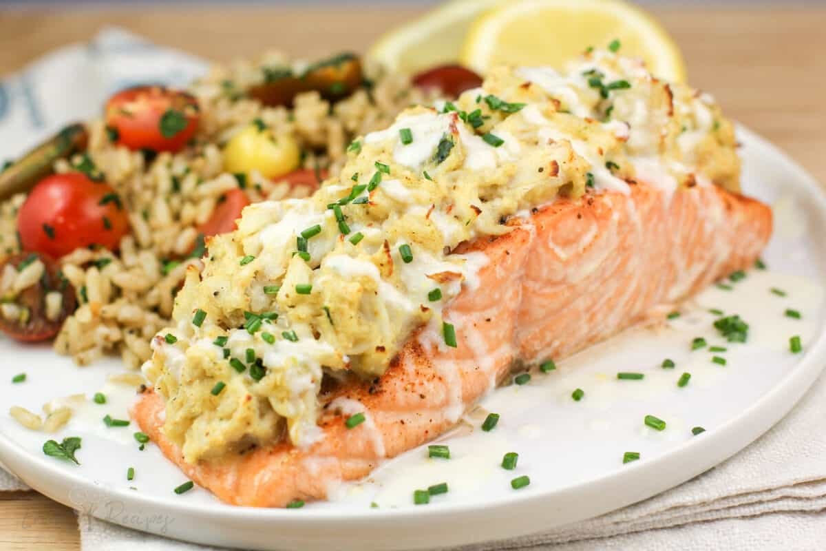 side view assembled stuffed salmon on white plate