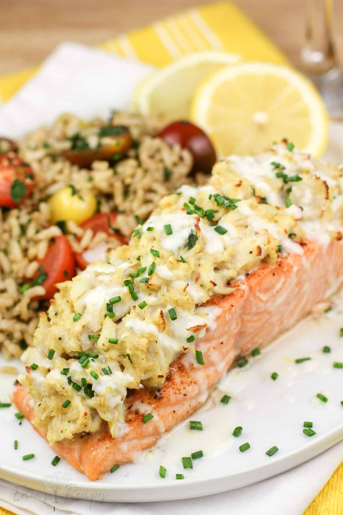 plated portion or salmon on white late with lemon and brown rice