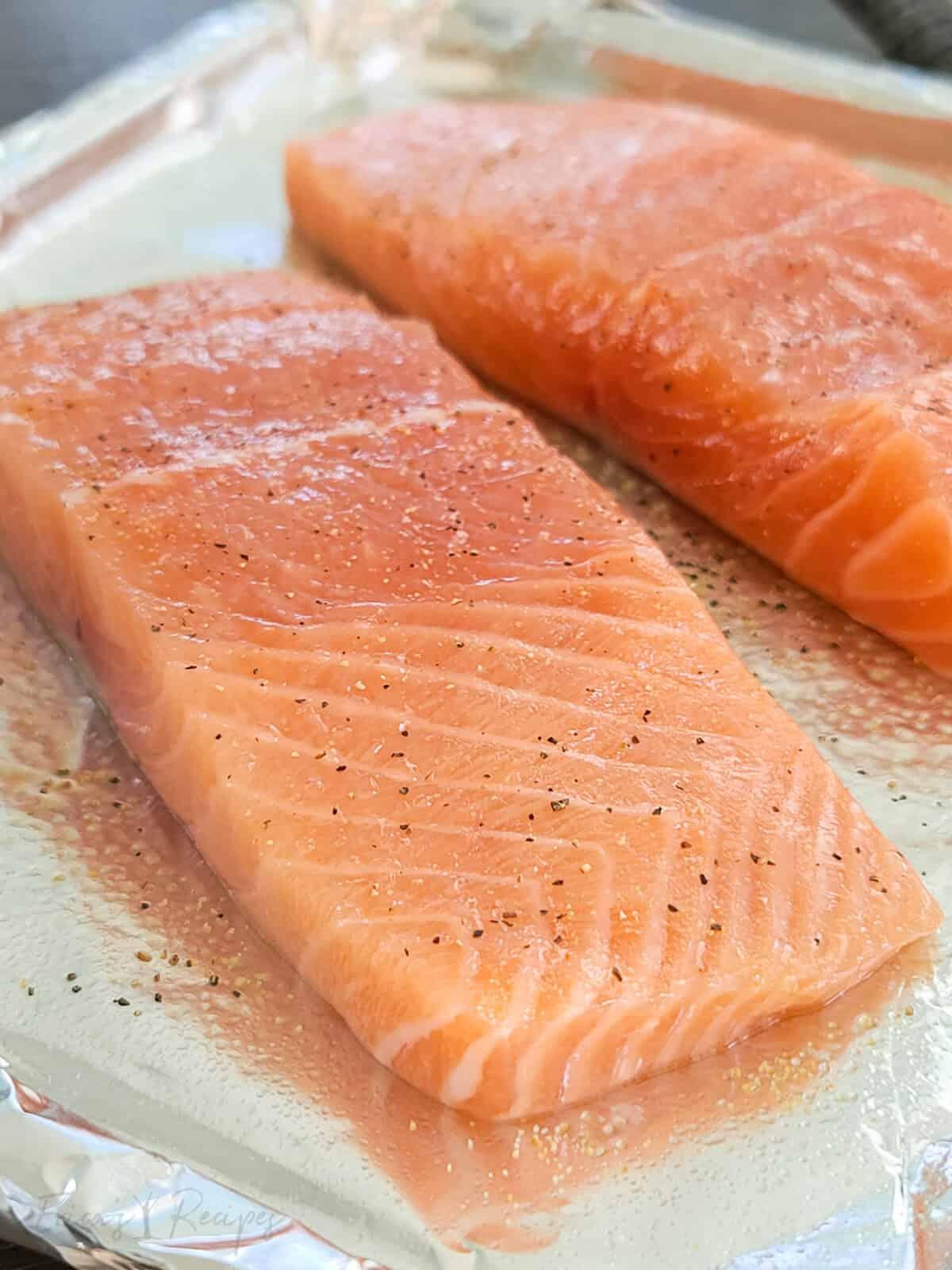 raw salmon on bake pan